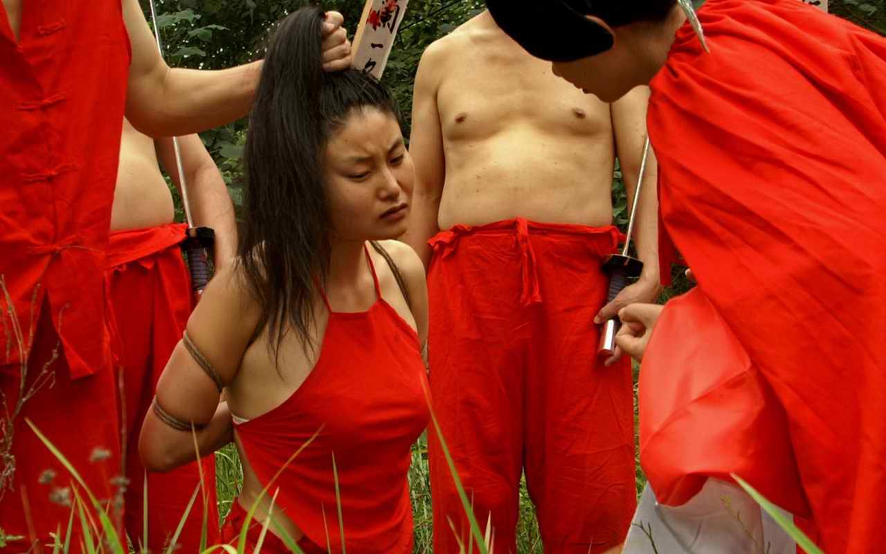 猎奇斩女犯的刽子手图片